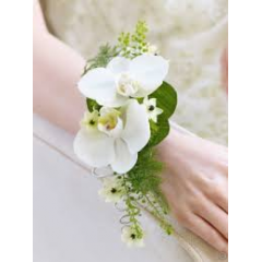 White phalaenopsis orchids gracefully frames the wrists.  Orchids are on the larger size so be aware of the wrist size.