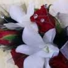 White dendrobian orchid with red roses.  small rhinstones are included inside the roses.