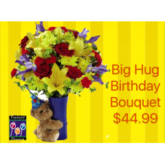 "The Fremont Flowers Big Hug® Birthday Bouquet is that perfect way to say ""Happy Birthday"" to any of the special people in your life in celebration of their big day! Full of color and life to let them know the party has started, this fresh flower arrangement brings together yellow Asiatic Lilies, red roses, red carnations, yellow chrysanthemums, red mini carnations, blue iris, and lush greens to create an eye-catching display. Presented in a blue ceramic vase with a plush brown bear donning a party hat sweetly hugging it tightly on the side, this birthday bouquet is a unique gift blooming with festive fun and love at every turn."
