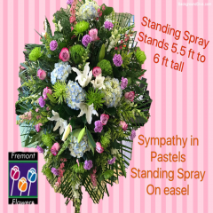 This beautiful standing tribute comes on a floral easel and stands 5 1/2 to 6 feet tall. It features lavender roses Lillys hydrangeas carnations snapdragons solid Astor and spider mums.