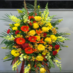 A beautiful standing floral tribute. Stands 6 feet tall. Beautiful fall tones -an outstanding tribute.