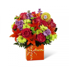 They will know that a good time is in store when this bright bouquet makes its appearance at any birthday celebration. Birthday joy seems to burst from a bright and beautiful ceramic vase that bears the festive look of a gift wrapped present. The colorful flowers include roses, lilies, stock and carnations...and are topped off with a heavy-weight yellow paper Happy Birthday!