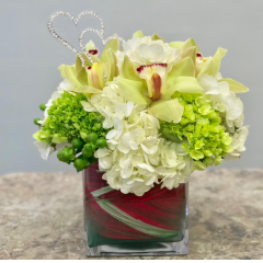 The Fremont Jade from Fremont Flowers....part of our petal zoom floral services available for same day delivery.  This unique creation include hypericum, hydrangea and cybidium orchids.  This is the perfect bouquet to celebrate a number of lifes occasions, birthdays, an anniversary, get well wishes or congratulations!