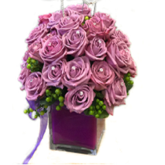 Two dozen roses are arranged in a coordinating cube, each rose has a crystal pin attached. The rhinestone numbers can be changed to celebrate any anniversary or birthday