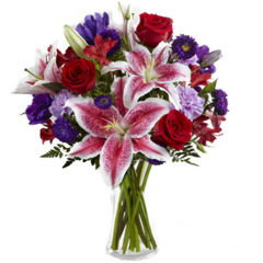 The Stunning Beauty™ Bouquet is an absolutely lovely way to send your love and affection across the miles. Fragrant Stargazer lilies stretch their star-like petals across a bed of rich red roses, lavender carnations, red Peruvian lilies, purple double lisianthus, purple matsumoto asters and lush greens. Presented in a classic clear glass vase, this elegant bouquet is an incredible way to convey your sweetest sentiments.