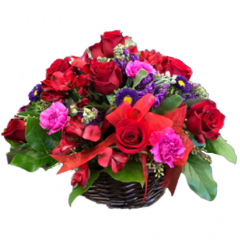 A variety of Roses, Carnations, Lisianthus and Alstroemeria combine in purples and reds to create this basket full of happy wishes.  One of our most striking arrangements.