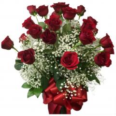 Two dozen long stem roses arranged in a vase