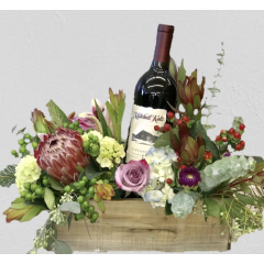 A beautiful blend of exotic, unusual flowers with a Mitchell Katz Zinfandel.  These are custom designed arrangements and no two are alike.  Please call our shop for more details.
