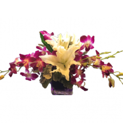 Orchids and lilies with dusty miller