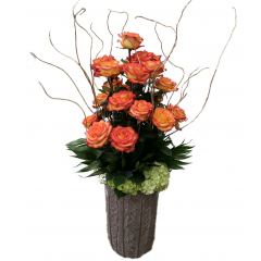 <h2><b> <b>This stunning arrangement will have you going Gaga!!  <br> <br> Standing nearly 4 feet tall. This lavish etched vase with golden trim is filled with 2 dozen premium long stemmed High & Magic two tone orange roses, bountiful bunches of Hydrangea, lush tropical greens, and gold gilded branches create a bold yet unassuming focal point for any area in your home, business, or event.  <br> <br> Local delivery only. <b> Rose color substitutions available upon request.