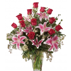 The Stargazing....a grand bouquet with red roses and stargazer lilies.  A seasonal favorite. This is one bouquet that is a show stopper.   Freedom red roses combine with Stargazer Lilies in a display that will certain get attention!  Order early to avoid a sell out!