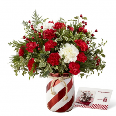 """<b> Fremont Flowers proudly presents the Better Homes and Gardens¨ Holiday Wishesª Bouquet. Come home for the holidays with this simply stunning fresh flower bouquet. Rich red roses and mini carnations create a splash of Christmas color accented with white carnations, berry pics, and fragrant holiday greens. Presented in a red and white striped candy cane inspired shining ceramic vase tied at the top with a natural rope accent to give it that down home feel, this gorgeous holiday bouquet is ready to send your warmest wishes to friends and family throughout the yuletide season.  <br> <br> AS SHOWN bouquet is approx. 13""""H x 12""""W.   <br> PREMIUM bouquet is approx. 14""""H x 13""""W.  <br> EXQUISITE bouquet is approx. 16""""H x 15""""W."""