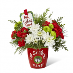 """Ring in the holiday season with friends and family in yuletide style and fresh beauty with The Fremont Flowers Jingle to That™ Bouquet by Hallmark! Rich red roses, red mini carnations, white chrysanthemums, green button poms, variegated holly, and fragrant holiday greens are arranged to perfection to create a winning Christmas gift. Presented in a ceramic red vase with the sentiment, """"I'll Jingle to That!"""" in white lettering on the front and a single jingle bell hanging at the center, this fresh flower bouquet is also accented with a hand lettered keepsake Hallmark tag that reads, """"Oh What Fun!, inside reads, Jingly Christmas Wishes!"""" to create an unforgettable way to send your merriest wishes near and far this Christmas season. 10""""H x 11""""W. BETTER bouquet is approx. 12""""H x 12""""W. BEST bouquet is approx. 13""""H x 15""""W. EXQUISITE bouquet is approx. 14""""H x 16""""W."""