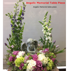 The Angelic Memorial Table Tribute for memorial services can be placed in the front of the chapel or church on a remembrance table along with pictures and other life significant items.  The angel (Cherub) can be removed and replaced with an Urn containing the cremains during the service. A variety of colors are available in floral choices. Custom ribbons can be added at additional cost.