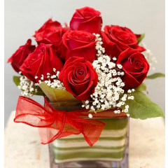 The Fremont Flowers Cupid's Cube!  This arrangement of red freedom roses features the classic flower of the holiday!  Features include glass cube vase for ease of transport for the recipient, should there be a desire to take it home if it is to be delivered to work.