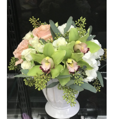 The Orchid compote bouquet mixes cybidium orchids with roses and seeded eucalyptus...the perfect floral gift for a variety of occasions.  Only available at Fremont Flowers.