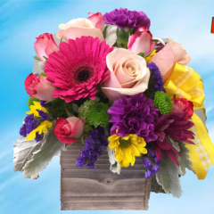 This relevant bouquet features a wood style box and is full of spring flowers.  Roses, Gerberas carnations, dusty miller and statice fill this crafty wooden box.