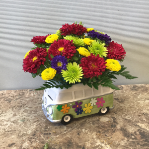 A 1960s Volkswagen bus filled with fresh florals! Only available in our local delivery area