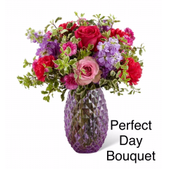 "The Perfect Day Bouquet is a charming way to celebrate any of life's most treasured moments, great and small. Blossoming with unmatched color and texture, this fresh flower arrangement brings together pink roses, hot pink roses, purple stock, hot pink carnations, violet mini carnations, and lush greens to create a gorgeous presentation. Arriving arranged in a purple glass vase with diamond pattern throughout to add even further texture and interest and give it an appealing vintage vibe, this spring flower bouquet is ready to help you send your warmest birthday, anniversary, or thank you wishes. GOOD bouquet is approx. 13""H x 11""W. BETTER bouquet is approx. 14""H x 12""W. BEST bouquet is approx. 15""H x 13""W. EXQUISITE bouquet is approx. 15""H x 15""W. **vase style may vary subject to availability"