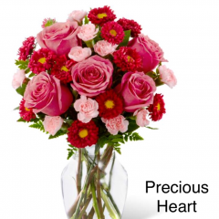 "The Precious Heart Bouquet is an expression of love and sweet surprises that is set to truly delight your special recipient! Popping with the swirl of hot pink roses surrounded by the alluring textures of red matsumoto asters and pale pink mini carnations, all beautifully accented with lush greens, this fresh flower arrangement has a winning look everyone can appreciate. Presented in a clear glass vase, this gorgeous flower bouquet is ready to create an excellent gift for any occasion. GOOD bouquet is approx. 14""H x 12""W. BETTER bouquet is approx. 15""H x 13""W. BEST bouquet is approx. 16""H x 14""W."