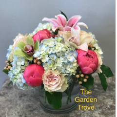 Peonies!!!! A favorite of many!  While in season only, a plethora of flowers including hydrangea, Peonies, (when in season) orchids and roses combine in a elegant glass cube.  A very tasteful gift.  (Substitutions will be necessary when seasonal varieties are not available)