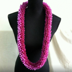 Double orchid roll lei.  All leis require advanced orders.  Subject to availability...and require 3-5 day advance ordering.  Call for availability