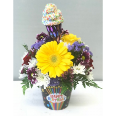 The Birthday Bash Bouquet from Fremont Flowers.  Bright mixed flowers in a keepsake birthday container.  This bouquet includes a whimsical ice cream cone to top it off!  Available for pickup or in our local delivery area only.