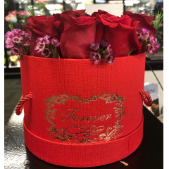 A lovely gift for special occasions- fresh roses collared with sweet waxflower in a hat box.  Available in the Fremont Flowers delivery area only.  Limited quantities.