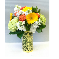 The Jamaica, inspired by the colors and rhythm of the tropical island.  Hydrangea, gerberas, stock roses and carnations combine in happy colors!  No stress bouquet.
