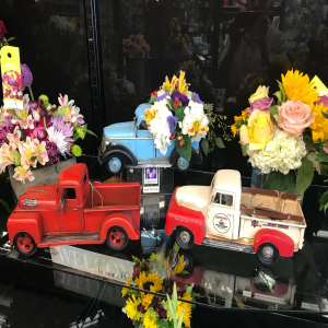 "The ""you're a classic dad ""bouquet in a keepsake antique metal truck. Limited selection of colors. Only one of each color available...sold as a first come, first served."