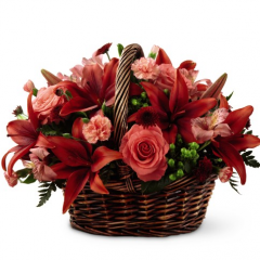As the seasons change, give a gift that will leave a lasting smile on their face. With roses, orange spray roses, orange gerbera daisies or lilies, and an assortment of lush greens, this array of harvest hues is a memorable bouquet, perfect for every Autumn moment. Presented in a rustic, dark wooden basket to create an arrangement ready to be used as a centerpiece or decorate a countertop or console table, this makes a perfect seasonal gift.