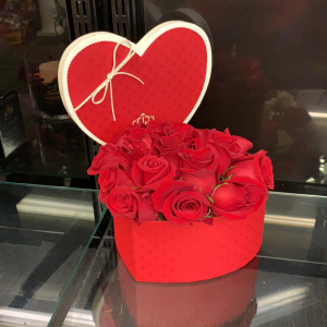 Roses arranged in a heart shaped hat box.  Watch the featured video for additional detail