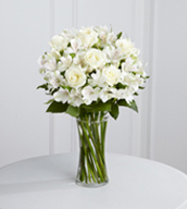 The Cherished Friend™ Bouquet offers comfort and sympathy in the time of grief and loss. Bright white roses and Peruvian lilies are accented by lush greens and gorgeously arranged in a clear glass gathering vase to create a bouquet that will bring peace and show how much you care.
