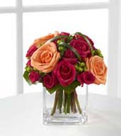The Deep Emotions® Rose Bouquet showers your special recipient with affection and admiration in sun-crushed hues. Deep fuchsia roses and spray roses share the spotlight with bright orange roses, green hypericum berries and lily grass blades gorgeously arranged in a clear glass vase. Fresh and eye-catching with extraordinary color, this bouquet will evoke warm feelings with its undeniable charm.