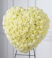 The Elegant Remembrance™ Standing Heart is an exquisite display of peace and love.  77 stems of white roses are artfully arranged in the shape of a heart and presented on a wire easel, creating a simply beautiful tribute for their final farewell service.
