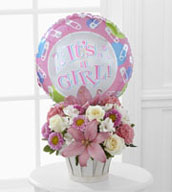 "The Girls Are Great!™ Bouquet is blooming with sweet love to congratulate the new family on their darling baby girl! White roses, white Peruvian lilies, pink carnations, pink matsumoto asters, pink Asiatic lilies and lush greens are beautifully arranged in a round whitewash woodchip basket. Presented with a Mylar balloon declaring, ""It's a Girl!"" this incredible flower arrangement is the perfect welcome for their new addition."