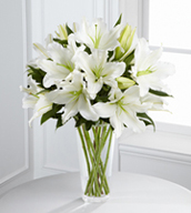 The Light In Your Honor™ Bouquet is a beautifully bright arrangement bursting with elegant fragrance to convey your deepest sympathies for the loss of their loved one. A stunning bouquet of gorgeous Oriental lilies are accented with lush greens and seated in a clear glass vase to create a bouquet that is serenely sophisticated, offering comfort and peace in their time of need.