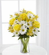 The FTD® Sunny Sentiments™ Bouquet is a blooming expression of charming cheer. Brilliant yellow roses and Peruvian Lilies are paired with white traditional daisies and green button poms to create a memorable bouquet. Accented with lush greens and arranged in a classic clear glass vase, this bouquet is a wonderful way to celebrate any of life's special moments