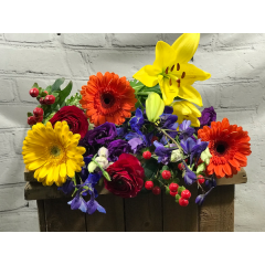 A custom design of bright blossoms for an uplifting sentiment for all occasions. - please indicate in special instructions if you have a preference of a low and compact style or tall and airy.