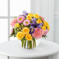 "6"" Bubble Bowl Filled To The Top With A Colorful Assortment Of Spray Roses, Carnations, Iris, Asters And Hypericum Berry This versatile vase arrangement is a welcome addition for any party or occasion that calls for a celebration."