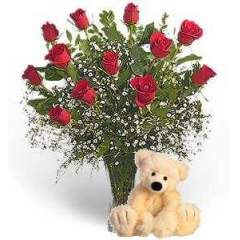 One Dozen Roses Accented With One Of Our Adorable Plush Animals - We Carry A Nice Selection Of Plush And Roses.
