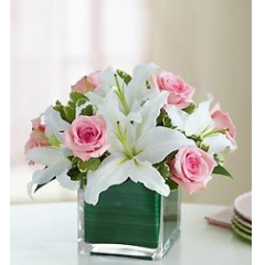 A stylish bouquet of roses and lilies. This petite arrangement is perfect for a office desk,table for two or where space is limited.