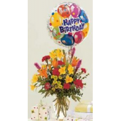 This bouquet simply shouts happy birthday, it's your day! Yellow and orange lilies, liatris and fun button poms arranged in a vase and tied with a mylar balloon.