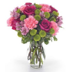 Deep pink roses, long-lasting peruvian lilies, pink carnations and vibrant green kermits are gathered into a vase for floral perfection!