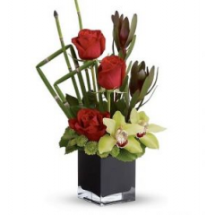A stylish design in a classic black cube of regal red roses and long-lasting cymbidium orchids.