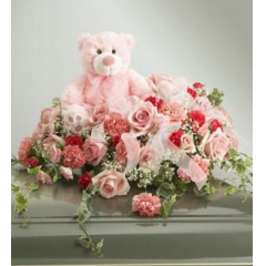 Beautiful Pink Roses And Pink Carnations Adorned With A Soft Pink Teddy Bear. Bring In One Or Yours Or Choose From Our Selection.