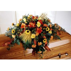 A Warm Casket Cover Perfect For A Man, Accented With Fall Colors And Wheat.