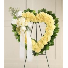 CLASSIC OPEN HEART DESIGN FEATURING ROSES AND CARNATIONS IN A TASTEFUL, ELEGANT TRIBUTE.
