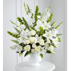The All White Arrangement Is A Beautiful Tribute That Stands Out At A Visitaiton Or A Service.