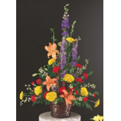 A Colorful Blend Of Summertimes Finest Blooms In A Brown Woven Basket, A Perfect Tribute For A Man Or A Woman.